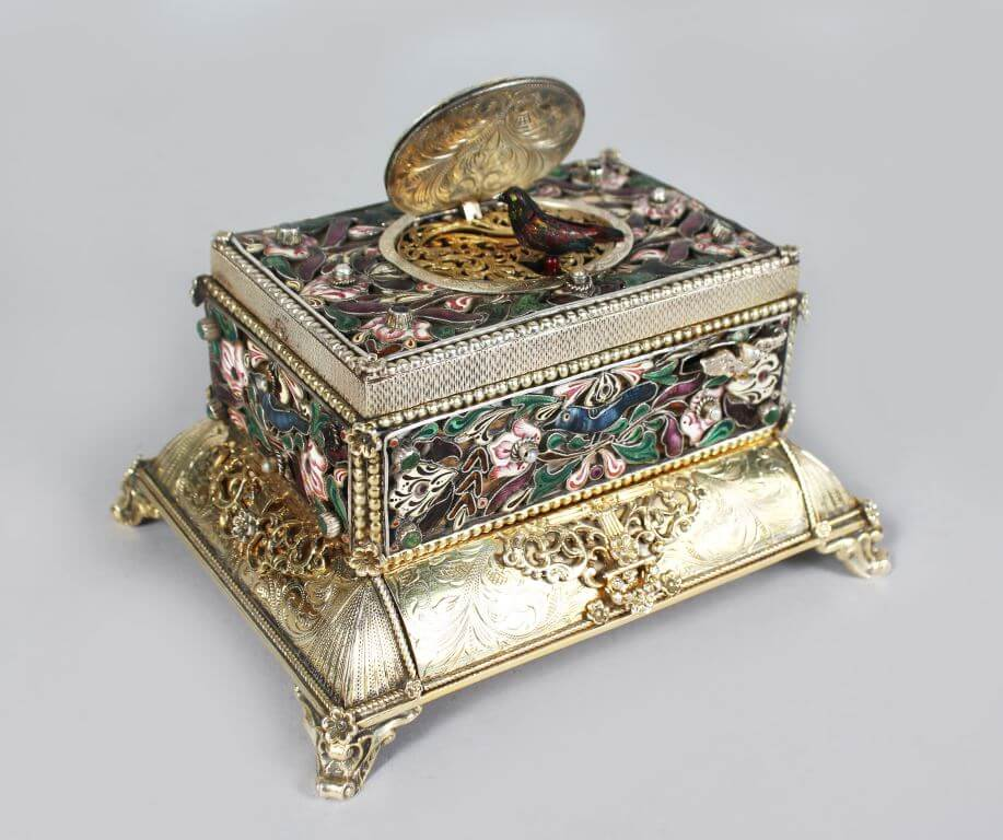 A superb 19th century German silver and enamel table singing bird musical box/Auctioneers and Valuers
