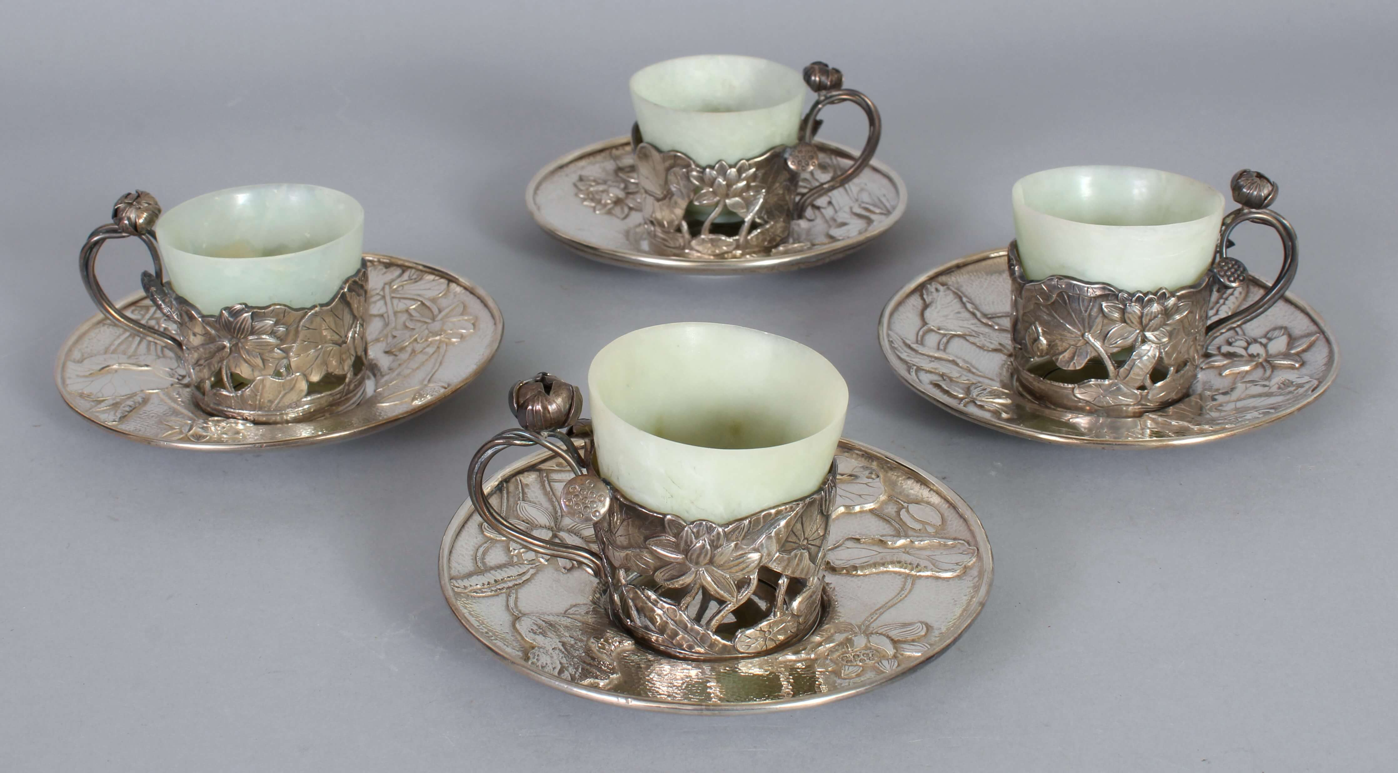 A set of four fine quality early 20th century Japanese art nouveau style silver & jade cups/Auctioneers & Valuers