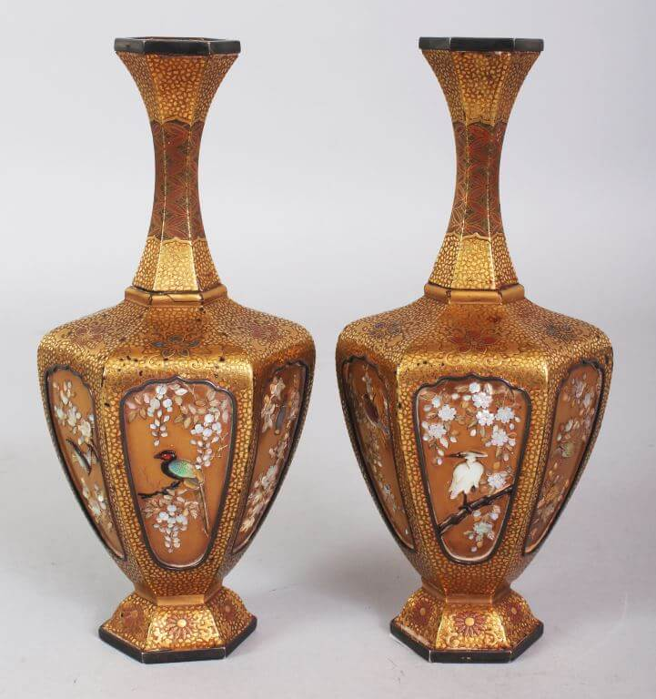 A pair of fine quality Japanese Meiji period Shibayama & Lacquer vases, 6.2in high./Auctioneers and Valuers
