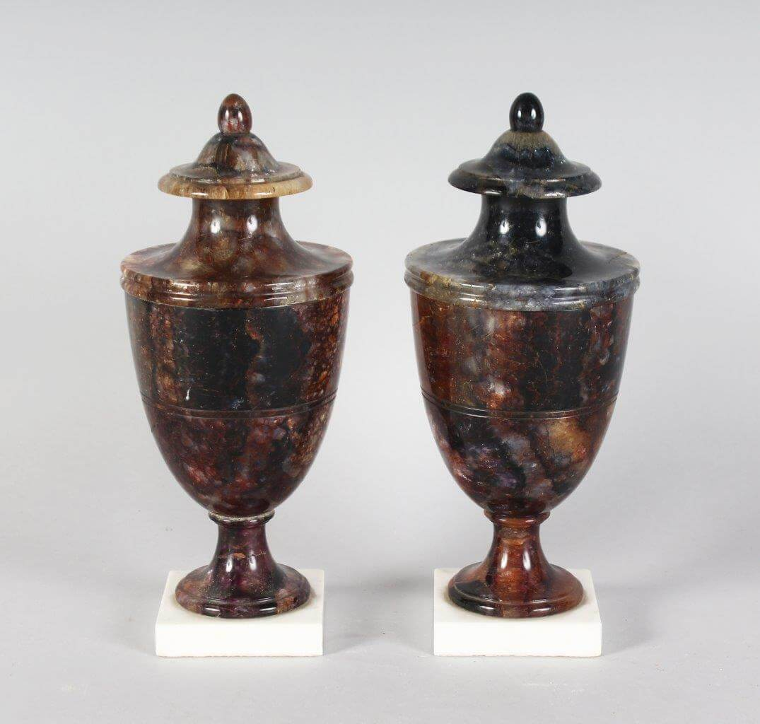 A superb pair of Regency Blue John Urns on Marble Bases/Auctioneers and Valuers