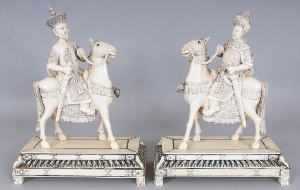 A pair of early 20th Century Chinese ivory models of a horse mounted/Auctioneers and Valuers