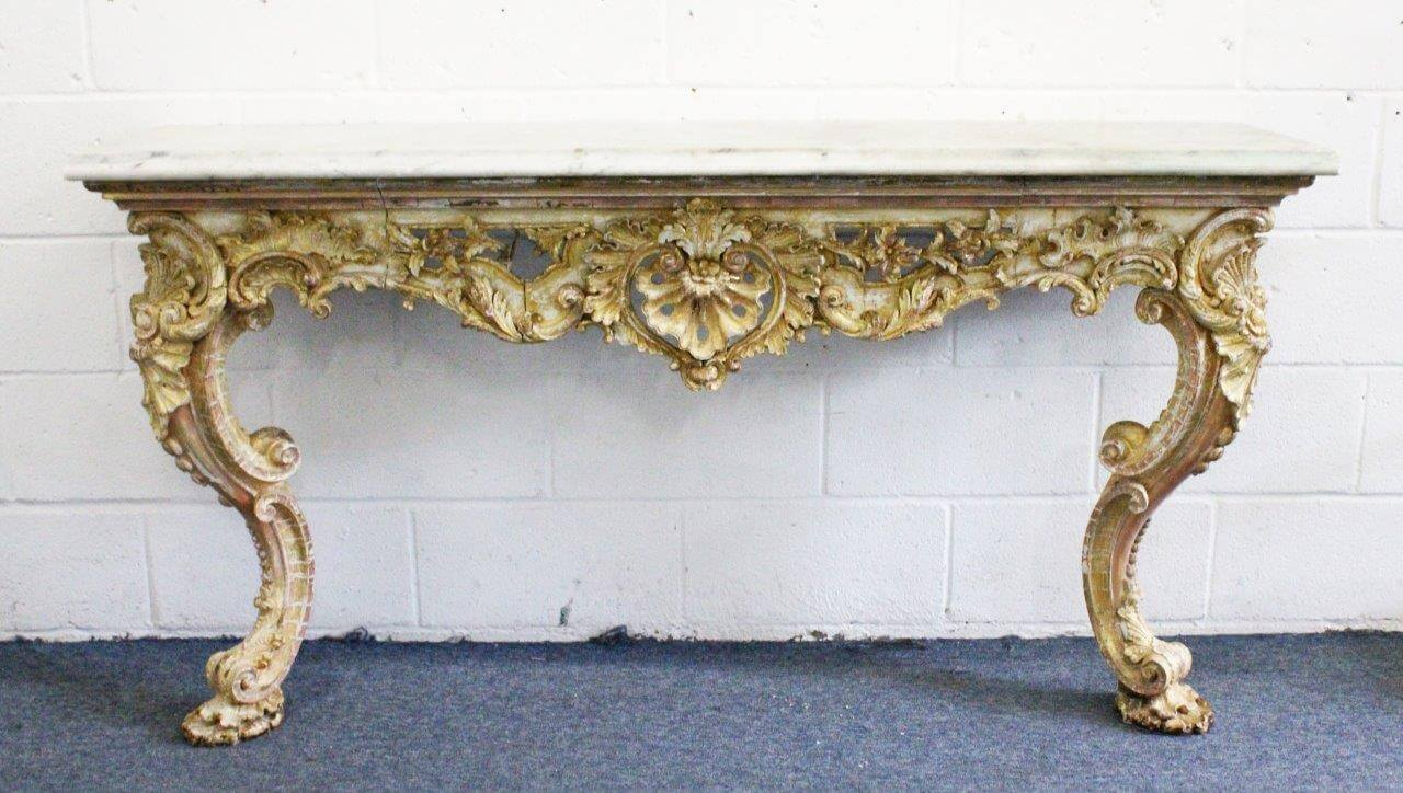 An 18th Century Florentine carved and gilded long console table/Auctioneers and Valuers
