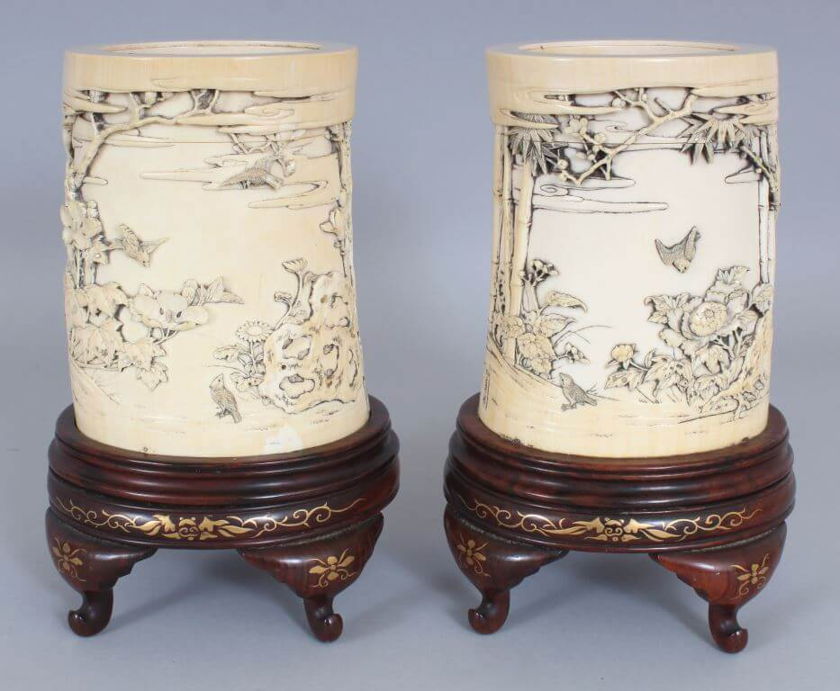 A pair of signed Japanese meiji period ivory tusk vases/Auctioneers and Valuers