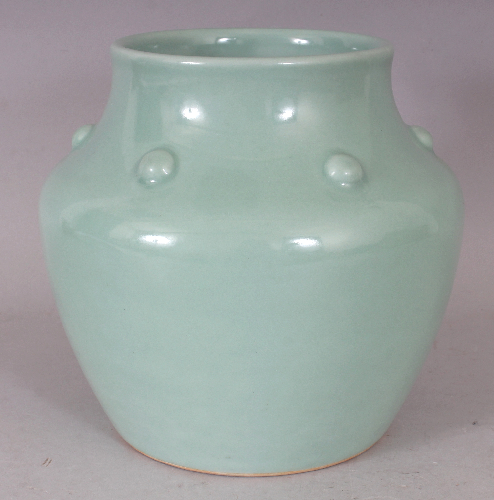 A fine quality Chinese Yongzheng mark and period Celadon porcelain vase, circa 1730/Auctioneers and Valuers