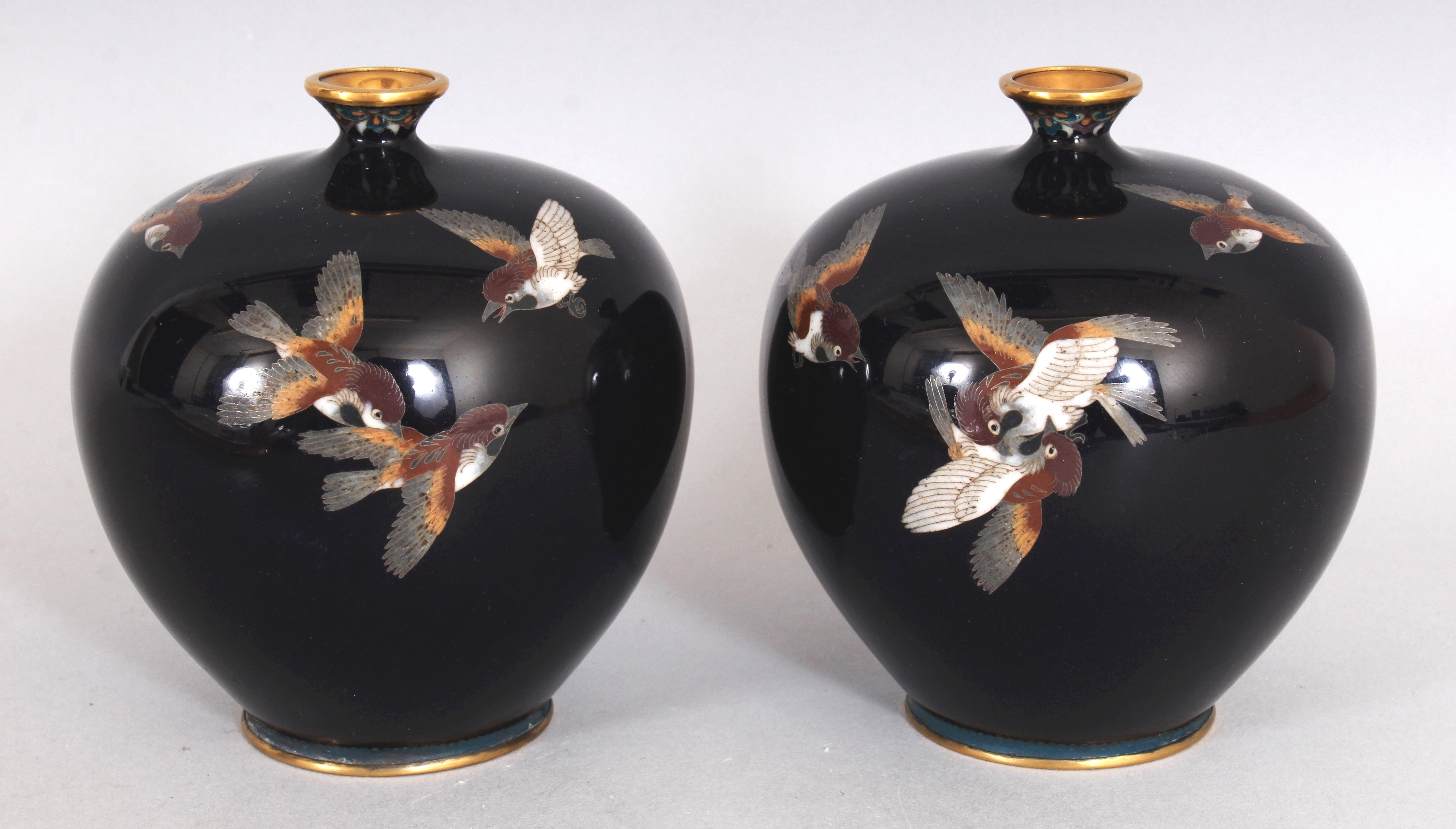 A pair of fine quality Japanese Meiji period midnight blue ground cloisonne vases by Inaba Nanaho/Auctioneers and Valuers