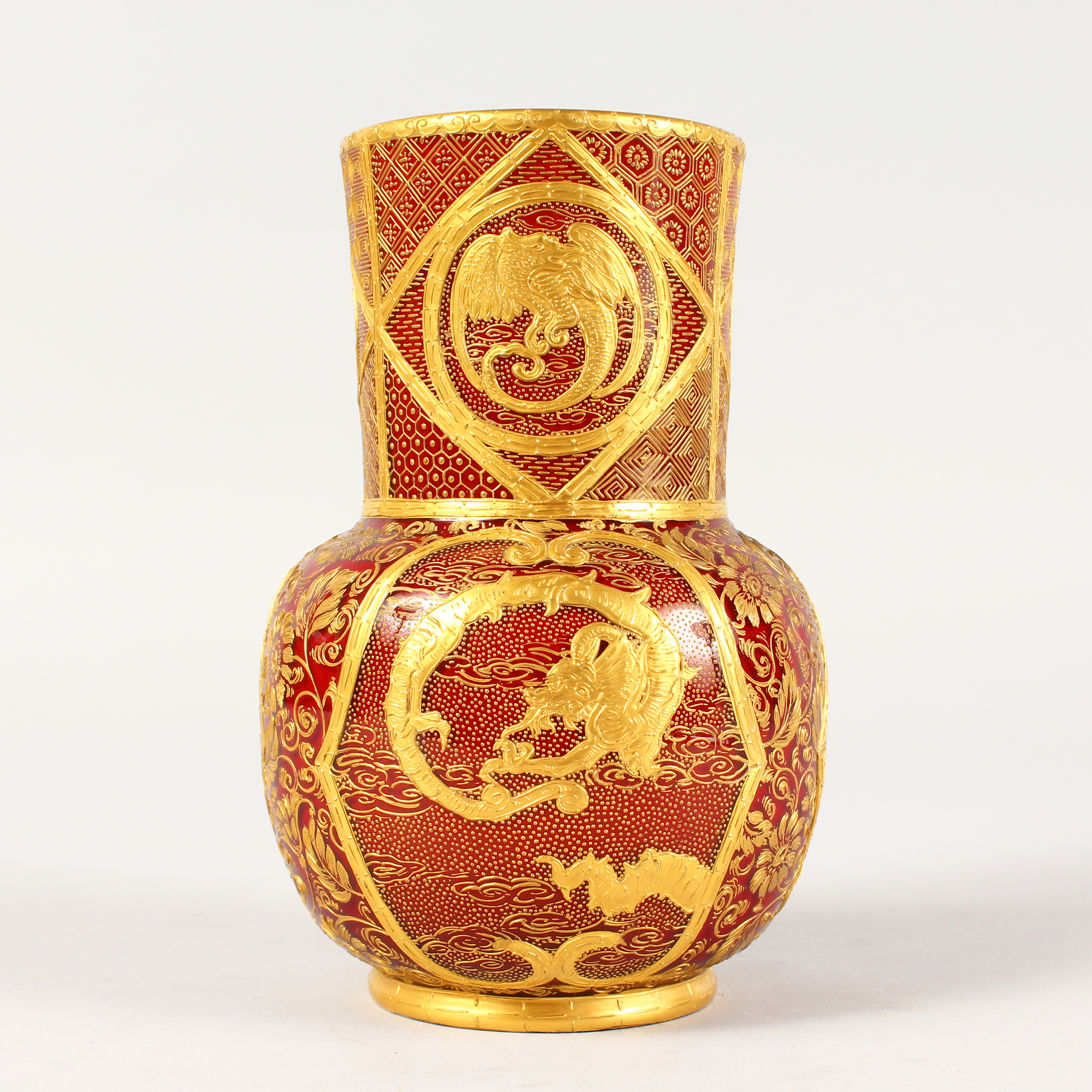 A superb English glass vase, decorated with dragons and flowers reputedly made for the Chinese Emperor./Auctioneers and Valuers