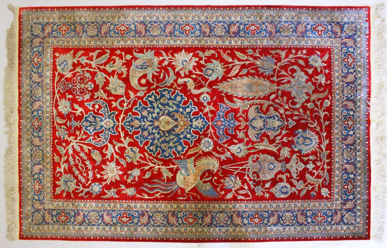 A good Persian part silk carpet, with central motif,/Auctioneers and Valuers