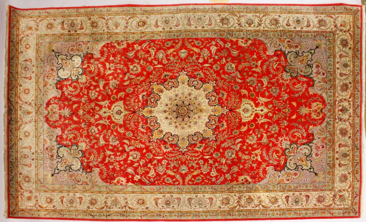 A good Persian carpet, with central motif, garlands and flowers/Auctioneers and Valuers