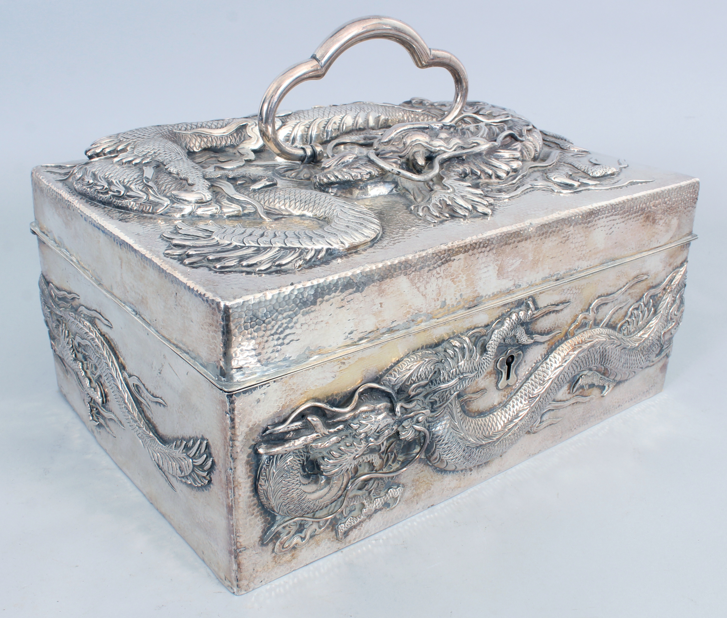 A good large Japanese Meiji period silver rectangular wood lined casket/Auctioneers and Valuers