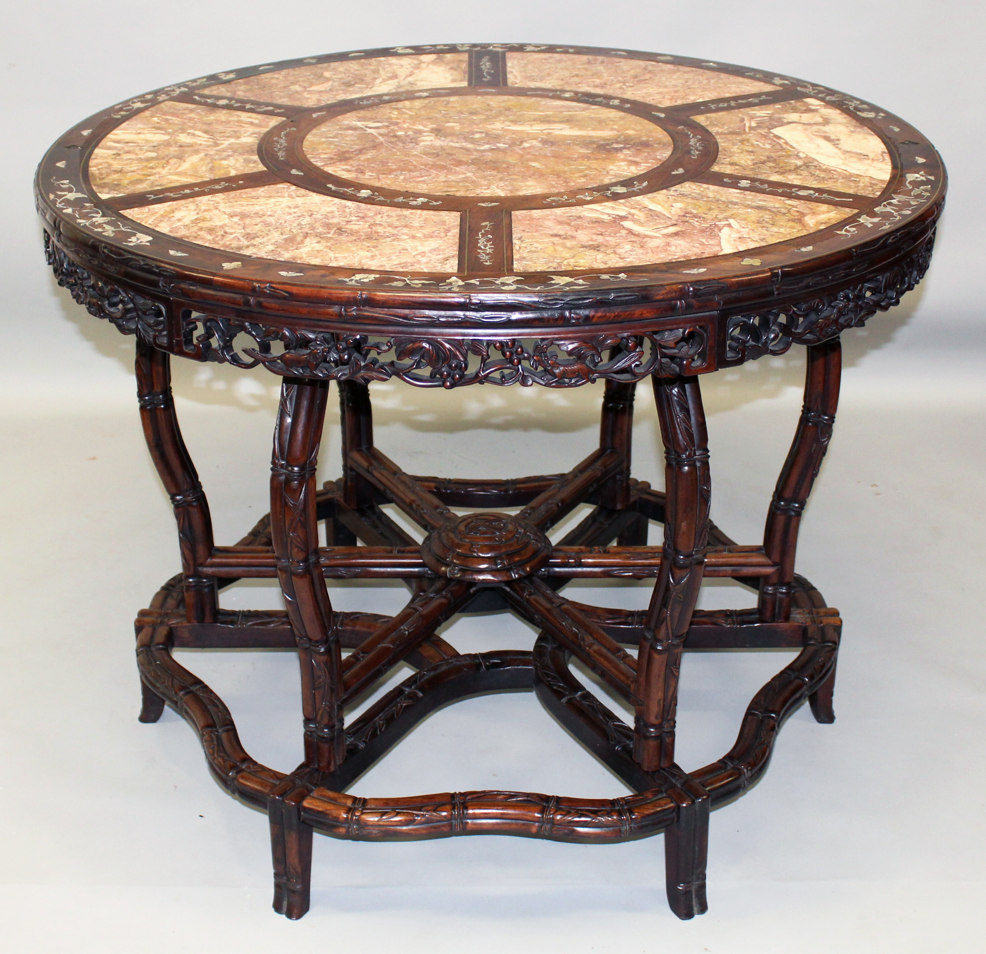 A large good quality 19th century Chinese circular pink marble top and mother-of-pearl inlaid carved Hongmu hardwood table/Auctioneers and Valuers