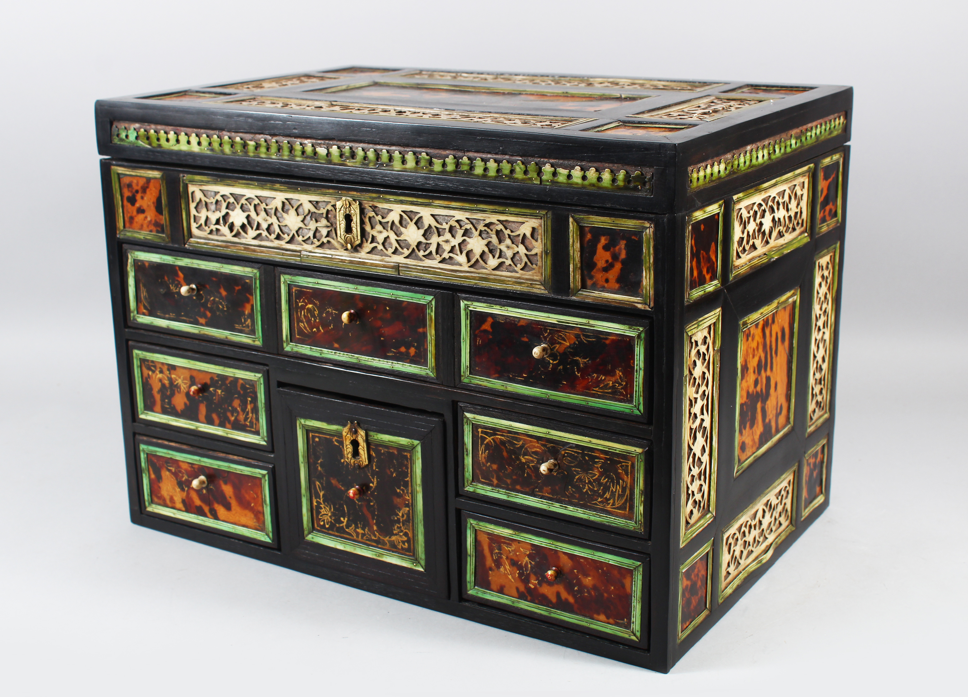 A good 17th Century Indo Portuguese ivory tortoiseshell and ebony table cabinet/Auctioneers and Valuers