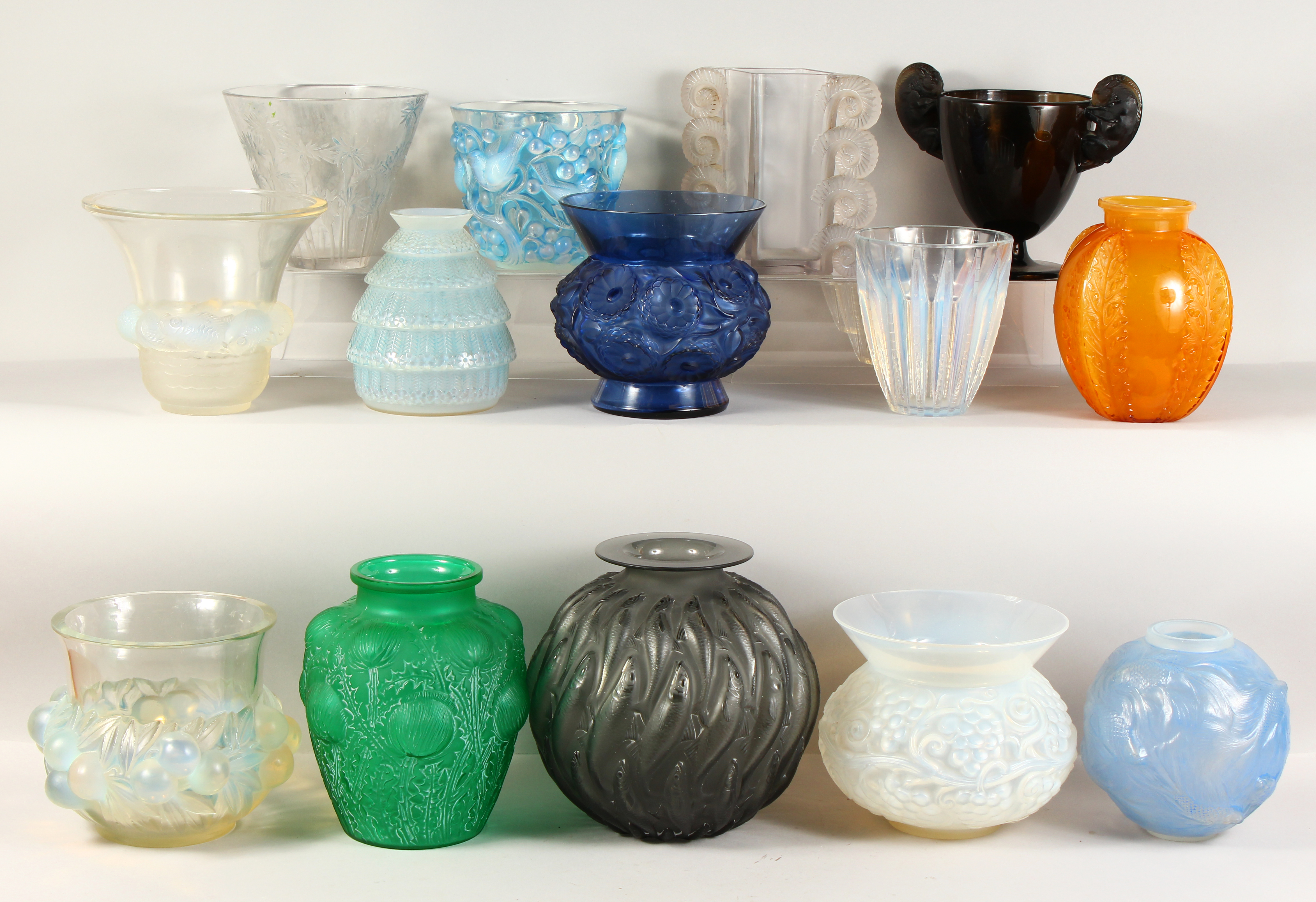 A single-owner collection of Lalique glass vases. /Auctioneers and valuers