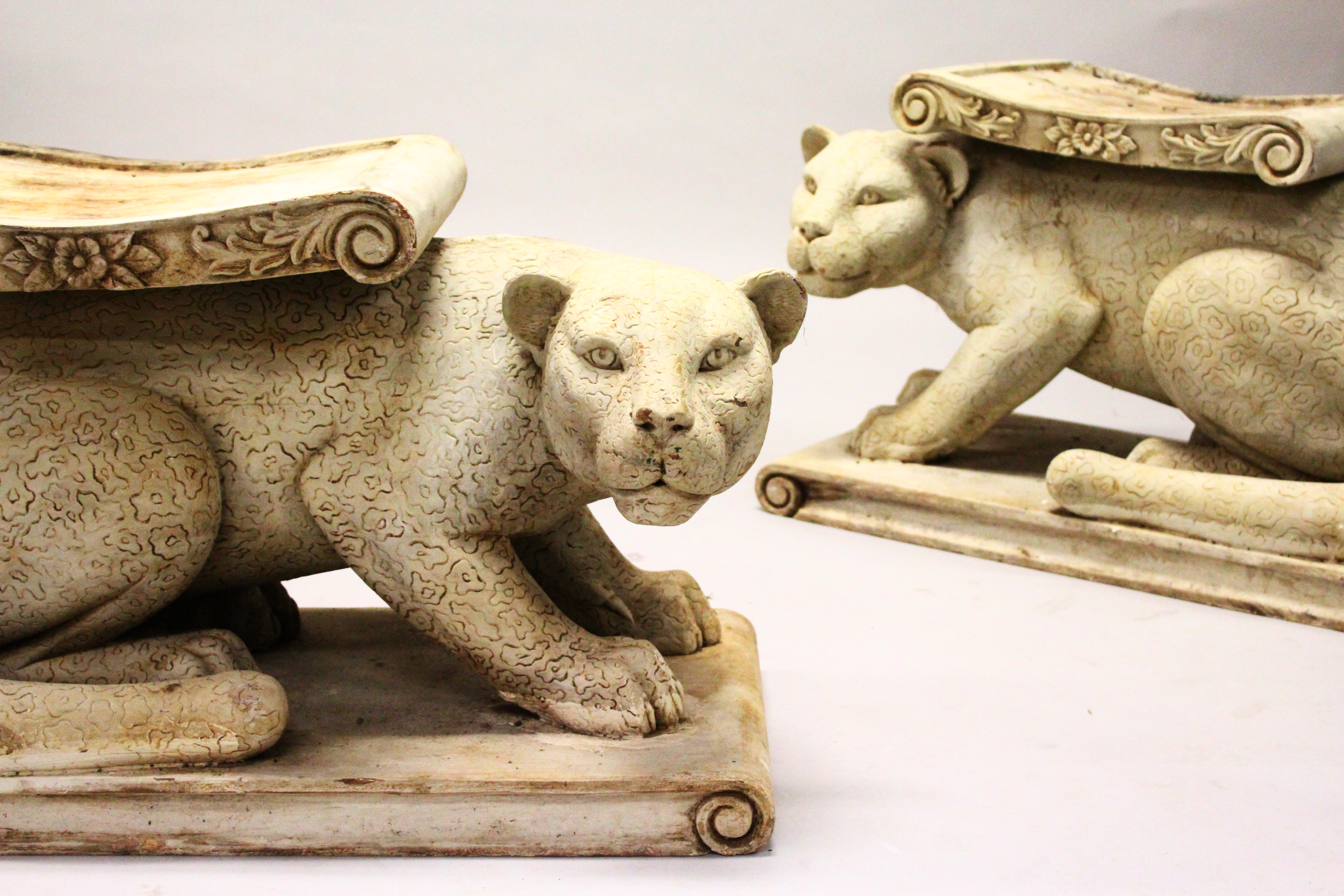 """A pair of carved and painted wood leopard garden seats. 2'6"""" Long/Auctioneers and Valuers"""
