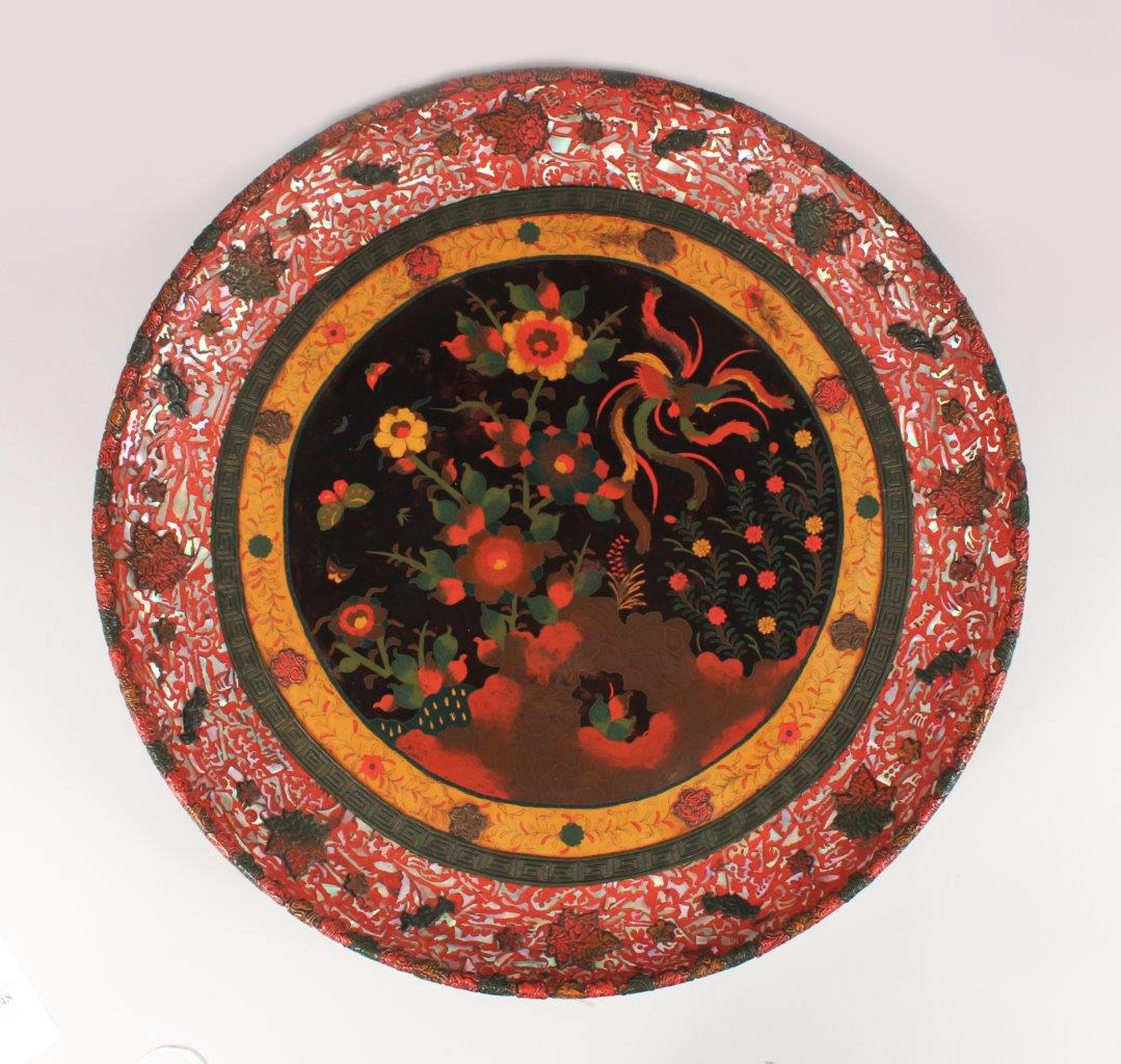 A rare Japanese ceramic plaque with a totei cloisonné centre and cinnabar lacquer. /Auctioneers and Valuers