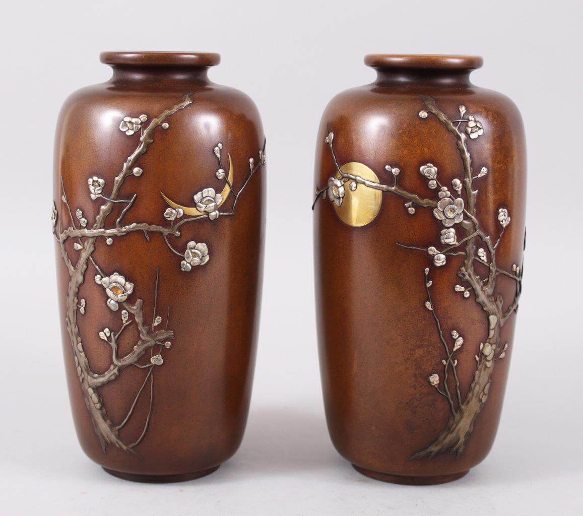 A good pair of Japanese Meiji period on laid bronize and mixed metal vases by the Nogawa Factory. /Auctioneers and Valuers