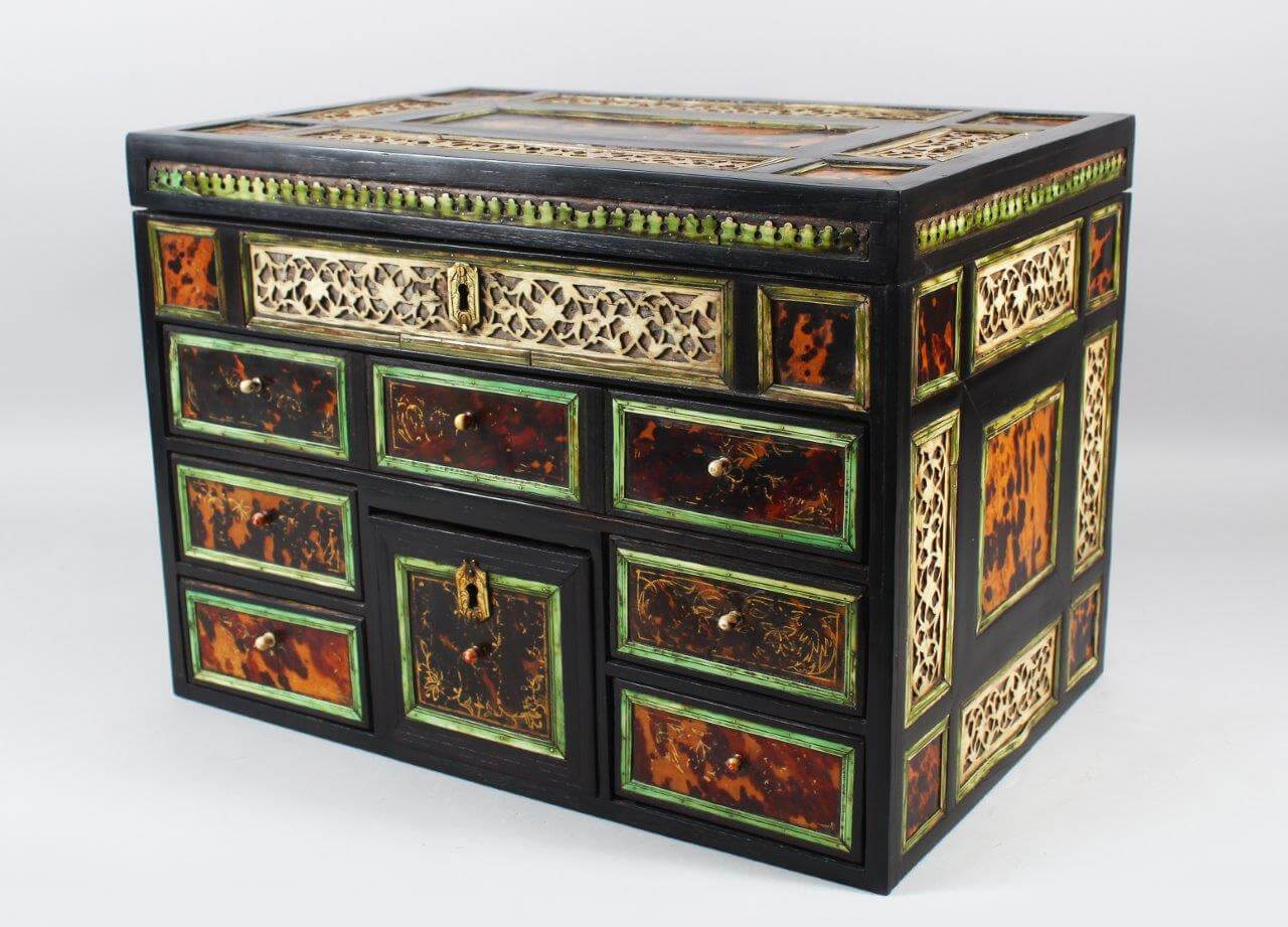A good 17th century Indo Portuguese ivory tortoiseshell and ebony table cabinet, /Auctioneers and Valuers