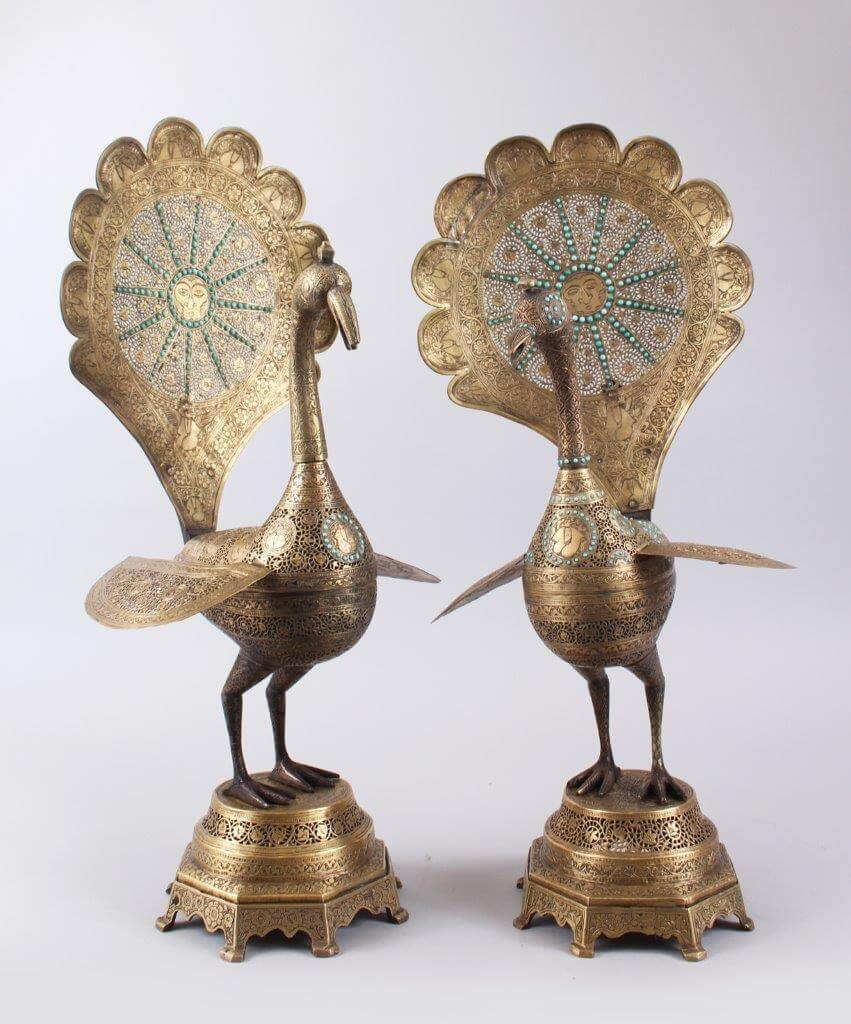 A superb pair of 19th century Persian pierced brass peacocks with turquoise beading standing on octagonal bases./Auctioneers and Valuers